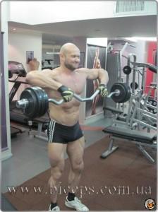 http://biceps.com.ua/wp-content/uploads/2010/05/tyaga-stoya-izognutoj-shtangi-k-podborodku-2-224x300.jpg